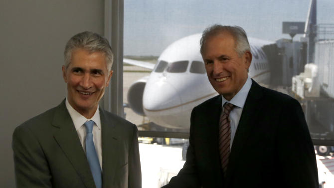 Jeff Smisek, Chairman, President and CEO, United Airlines, left, and Jim McNerney, Chairman and CEO, The Boeing Company, pose for photographers after the pair arrived on United Airlines Flight # 1, a Boeing 787 Dreamliner aircraft from, Houston, Texas, at Chicago's O'Hare International Airport Monday, May 20, 2013.  The planes are returning after being grounded for four months by the federal government because of smoldering batteries on 787s owned by other airlines. (AP Photo/Charles Rex Arbogast)