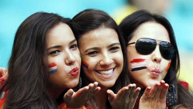 Costa Rica supporters blow kisses before the World Cup quarterfinal soccer match between the Netherlands and Costa Rica at the Arena Fonte Nova in Salvador, Brazil, Saturday, July 5, 2014. (AP Photo/Wong Maye-E)