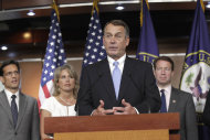 House Speaker John Boehner of Ohio, second from right, accompanied by fellow Republican leaders, talks to reporters about the debt crisis showdown during a news conference on Capitol Hill in Washington, Thursday, July 28, 2011. From left are House Majority Leader Eric Cantor of Va., Rep. Renee Ellmers, R-N.C., Boehner, and Rep. Peter Roskam, R-Ill. (AP Photo/J. Scott Applewhite)