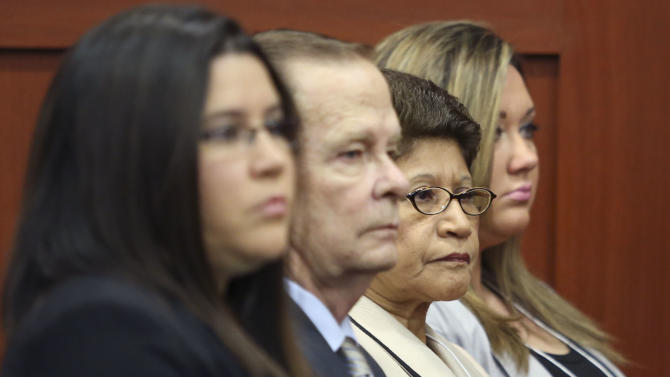 Gracie Zimmerman, left, sister of George Zimmerman, his father, Robert Zimmerman Sr., second from left, his mother, Gladys, second from right, and wife Shellie Zimmerman, right, sit in Seminole circuit court during George Zimmerman's trial in Sanford, Fla., Thursday, June 20, 2013. Zimmerman has been charged with second-degree murder for the 2012 shooting death of Trayvon Martin.(AP Photo/Orlando Sentinel, Gary Green, Pool)