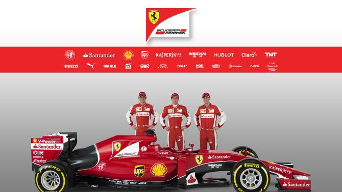 Undated handout image of Ferrari Formula One drivers Gutierrez, Raikkonen and Vettel posing with the new Ferrari F1 SF15-T in Maranello