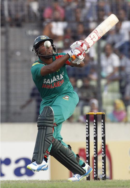 Bangladesh's Mahmudullah reacts after a ball hit his face during their first ODI cricket match against New Zealand in Dhaka