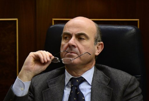 <p>Spain's Economy Minister Luis de Guindos attends parliament in Madrid on December 20, 2012. Spain on Wednesday ruled out any Irish-style bailout for the recession-hit, jobs-starved economy, but said it was still undecided about seeking intervention by the European Central Bank to bring down its debt financing costs.</p>