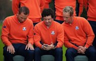 Rory McIlroy of Northern Ireland (C) shows Luke Donald of England (R) something on his iPhone as they pose for a group photo at Medinah Country Golf Club in Medinah, Illinois, September 25, ahead of the 39th Ryder Cup with Sergio Garcia of Spain (L)