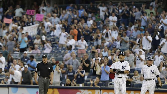 New York Yankees' Ichiro Suzuki, of Japan, stands at first base after hitting a single for his 4,000th career hit in Japan and the major leagues combined, during the first inning of a baseball game against the Toronto Blue Jays on Wednesday, Aug. 21, 2013, in New York. (AP Photo/Frank Franklin II)