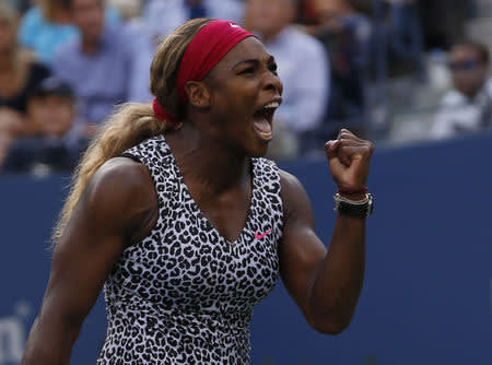 Williams of the U.S. celebrates a point against Wozniacki of Denmark during their women's singles finals match at the 2014 U.S. Open tennis tournament in New York
