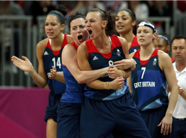 Great Britain's players react from the bench during game against France at their women's preliminary round Group B basketball match at the Basketball Arena during the London 2012 Olympic Games