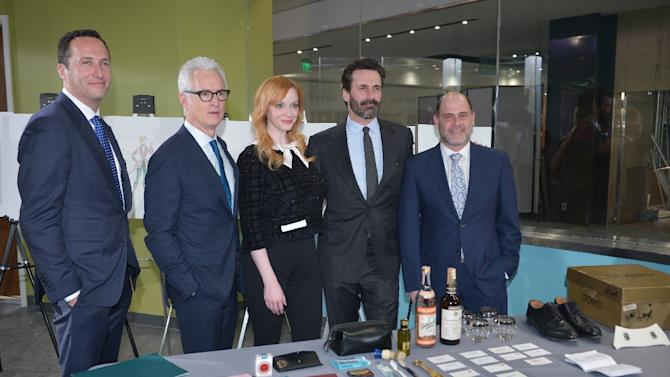 "(L-R) AMC President Charlie Collier, ""Mad Men"" cast John Slattery, Christina Hendricks and Jon Hamm, and series creator, writer and executive producer Matthew Weiner, at the Smithsonian National Museum of American History on March 27, 2015"