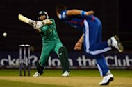 South African batsman Hashim Amla (L) plays a shot during the second 20-20 international cricket match between England and South Africa