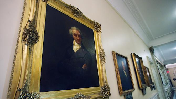 This photo taken March 20, 2014 shows a portrait of Massachusetts Gov. Elbridge Gerry hanging in a hallway at the Statehouse in Boston. For centuries, politicians have been drawing odd-shaped elections districts in an effort to give one political party an advantage over another. In 1812, the practice got a name: gerrymandering. That year, Gov. Gerry signed a bill passed in the Massachusetts legislature to redraw state Senate district map. (AP Photo/Elise Amendola)