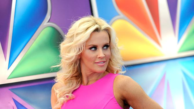 """FILE - This May 14, 2012 file photo shows """"Love In The Wild"""" host Jenny McCarthy arrives for the NBC network upfront presentation at Radio City Music Hall in New York. McCarthy, who is from suburban Chicago, released a statement Friday, Aug. 17, 2012, saying that she is no longer romantically involved with Chicago Bears linebacker Brian Urlacher. (AP Photo/Evan Agostini, file)"""