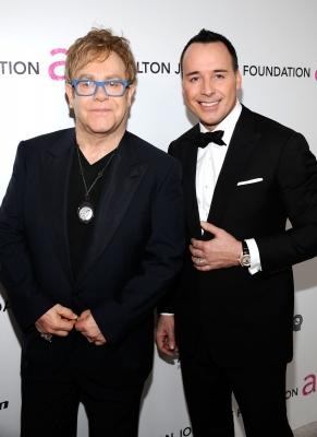 Elton John and David Furnish hit the red carpet at the 18th annual Elton John AIDS Foundation Academy Awards party, LA, March, 7, 2010 -- Getty Images