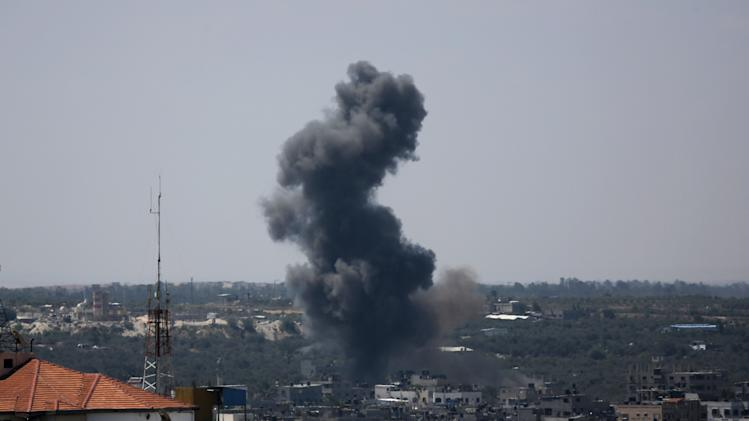 Smoke rises after an Israeli missile strike in Gaza City, Monday, July 14, 2014. Israel began airstrikes Tuesday against militants in the Hamas-controlled Gaza Strip in what it says was a response to heavy rocket fire out of the densely populated territory. The military says it has launched more than 1,300 airstrikes since then, while Palestinian militants have launched nearly 1,000 rockets at Israel.( AP Photo/Hatem Moussa)