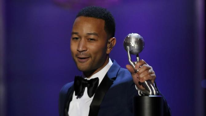 Musician John Legend accepts the President's Award at the 47th NAACP Image Awards in Pasadena