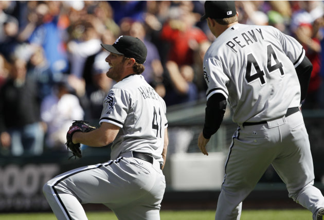 Chicago White Sox starting pitcher Philip Humber, left, reacts after pitching a perfect baseball game against the Seattle Mariners, Saturday, April 21, 2012, in Seattle. The White Sox won 4-0. (AP Pho
