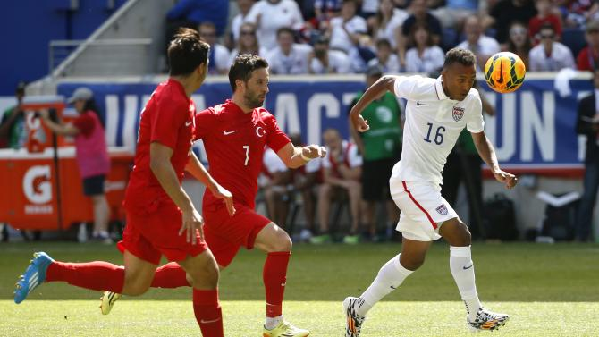 Green of the U.S. is challenged for the ball by Turkey's Gonul and Balta during their international friendly soccer match in Harrison, New Jersey