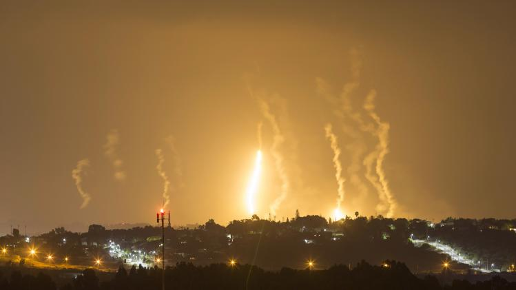 The Israeli community of Netiv Haasara is seen in front of flares fired by the Israeli army in Gaza