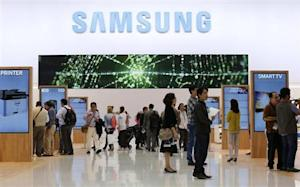 Journalists walk at the Samsung booth during a media preview day at the IFA consumer electronics fair in Berlin