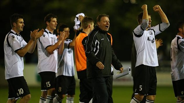 Cambridge City's management and players celebrate at the end of the game (PA Photos)