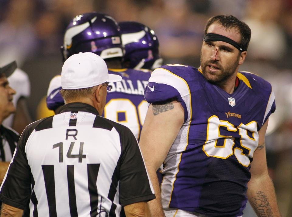 Minnesota Vikings defensive end Jared Allen reacts to referee Ron Winter, left, after getting in a tussle with Tampa Bay Buccaneers tackle Donald Penn during the second half of an NFL football game Thursday, Oct. 25, 2012, in Minneapolis. (AP Photo/Andy King)