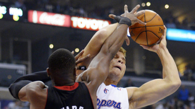 Los Angeles Clippers forward Blake Griffin, right, puts up a shot as Miami Heat guard Dwyane Wade defends during the first half of their NBA basketball game, Wednesday, Nov. 14, 2012, in Los Angeles. (AP Photo/Mark J. Terrill)