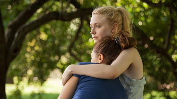 """This undated publicity film image provided by the Sundance Institute shows Dakota Fanning, right, and Elizabeth Olsen, in the film """"Very Good Girls,"""" included in the narrative premieres at the 2013 Sundance Film Festival in January. (AP Photo/Sundance Institute, Jessica Miglio)"""