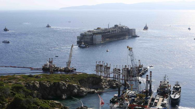 The cruise liner Costa Concordia starts to move anticlockwise during refloat operation maneuvers at Giglio Island