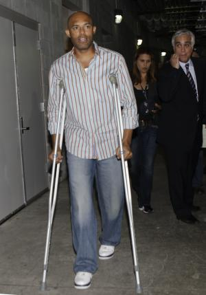 New York Yankees closer Mariano Rivera leaves a news conference on crutches after addressing the media before the Yankees baseball game against the Tampa Bay Rays at Yankee Stadium, Wednesday, May 9, 2012, in New York. Rivera suffered a season-ending leg injury shagging fly balls in the outfield before the Yankees game against Kansas City last week in Kansas City, Mo. (AP Photo/Kathy Willens)