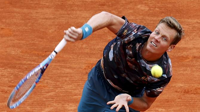 Berdych of the Czech Republic serves during his men's singles semi-final tennis match against Monfils of France  at the Monte Carlo Masters in Monaco