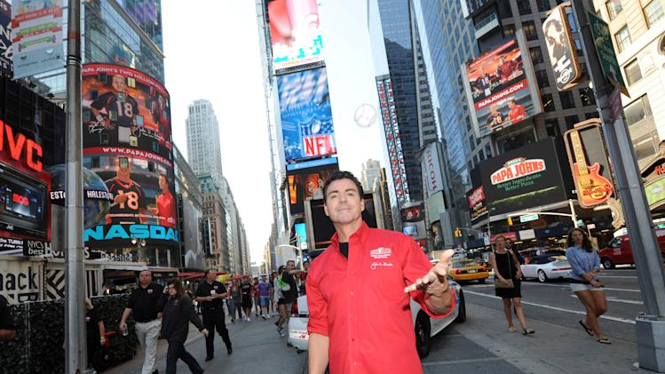 IMAGE DISTRIBUTED FOR PAPA JOHN'S INTERNATIONAL - Papa John's Founder, Chairman and CEO John Schnatter takes to the streets of New York's Times Square, Friday, Sept. 14, 2012, to celebrate the opening of the brand's 4,000th global restaurant.  Schnatter gave away 4,000 commemorative baseballs, each with a code redeemable for a free large pizza.  He will cap the celebration with a special on-field appearance at Friday's New York Yankees game. (Photo by Diane Bondareff/Invision for Papa John's International/AP Images)