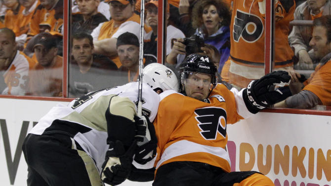 Pittsburgh Penguins' Chris Kunitz, left, knocks Philadelphia Flyers' Kimmo Timonen, of Finland, off the puck in the second period of Game 4 in a first-round NHL Stanley Cup playoffs hockey series on Wednesday, April 18, 2012, in Philadelphia. (AP Photo/Matt Slocum)