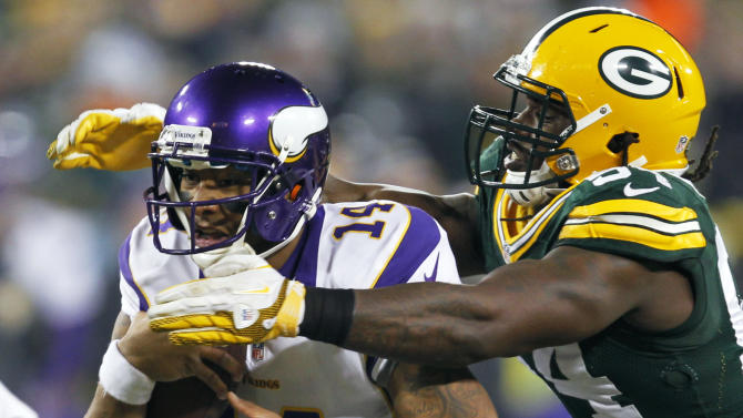 Green Bay Packers outside linebacker Dezman Moses, right, tackles Minnesota Vikings quarterback Joe Webb (14) during the first half of an NFL wild card playoff football game Saturday, Jan. 5, 2013, in Green Bay, Wis. (AP Photo/Mike Roemer)