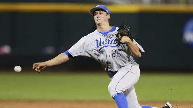UCLA closing pitcher David Berg delivers against Mississippi State in the ninth inning of Game 1 of the NCAA College World Series best-of-three finals, Monday, June 24, 2013, in Omaha, Neb. Berg had his 24th save as UCLA won 3-1. (AP Photo/Nati Harnik)