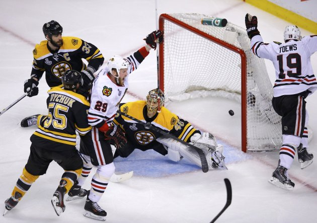 Blackhawks' Toews and Bickell celebrate Toews' goal on Bruins goalie Rask as Bruins' Chara and Boychuk follow the play during the second period in Game 4 of their NHL Stanley Cup Finals hockey series