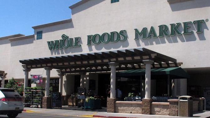 """A Whole Foods Market in Albuquerque, N.M. is shown Thursday June 6, 2013 during lunch time. Two employees at this Albuquerque store say they were suspended last month after complaining about being told they couldn't speak Spanish to each other while on the job. A spokesman for the the Austin, Texas-based company says it believes in """"having a uniform form of communication"""" for a safe working environment. (AP Photo/Russell Contreras)"""