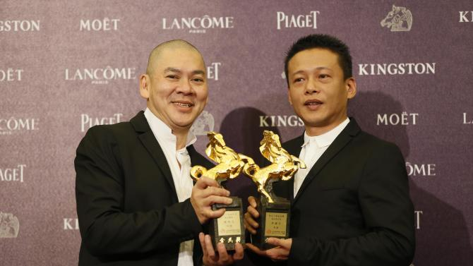 "Best director Tsai Ming Liang, left, and Best Leading Actor Lee Kang Sheng, hold their awards for their film "" Stray Dogs "" at the 50th Golden Horse Awards in Taipei, Taiwan, Saturday, Nov. 23, 2013. The Golden Horse Awards is the Chinese-language film industry's biggest annual events. (AP Photo/Wally Santana)"