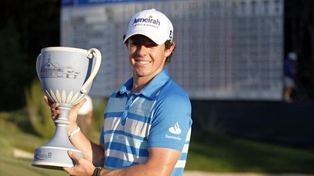 Rory McIlroy of Northern Ireland lines holds up the championship cup at the 18th hole after winning in the final round of the Deutsche Bank Championship (Reuters)