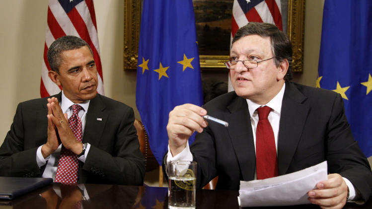 President Barack Obama listens as European Commission President Jose Manuel Barroso speaks with the media, Monday, Nov. 28, 2011, in the Roosevelt Room of the White House Washington. (AP Photo/Haraz N. Ghanbari)