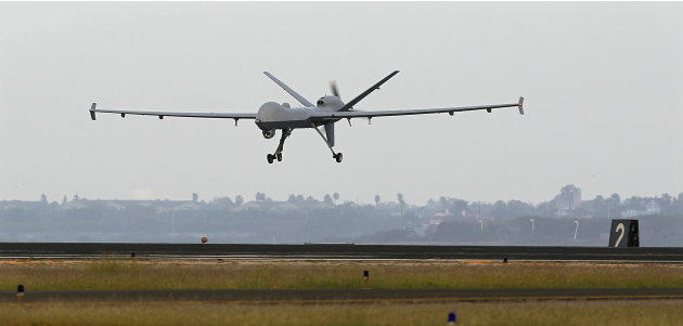 FILE - This Nov. 8, 2011 file photo shows a Predator B unmanned aircraft landing after a mission, at the Naval Air Station, in Corpus Christi, Texas. At the Air Force Academy in Colorado Springs, beco