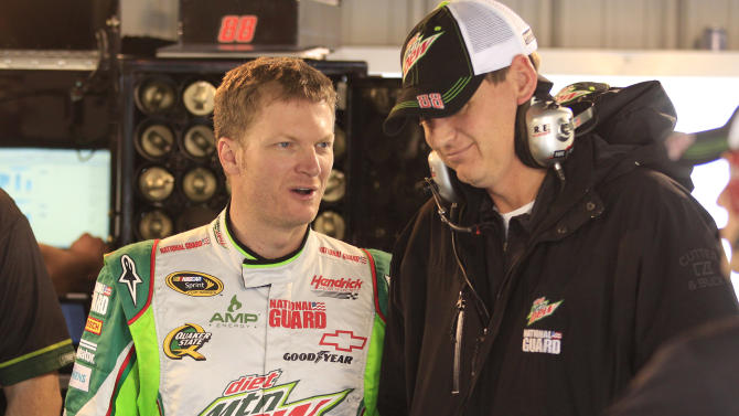Dale Earnhardt Jr., talks to crew chief Steve Letarte, right, during his first practice since recovering from concussions at Martinsville Speedway  in Martinsville, Va., Friday, Oct. 26, 2012.  (AP Photo/Steve Helber)