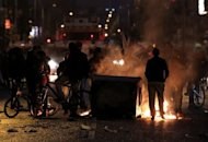 <p>Loyalist protesters burn debris on the lower Newtownards road in Belfast, Northern Ireland on January 5, 2013. Violence flared for the fourth night running in Northern Ireland on Sunday, hours after politicians and Church leaders held talks in a bid to quell a row over the flying of the British flag.</p>