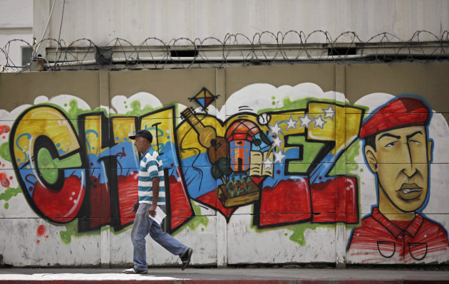 A man walks past a mural of Venezuela's President Hugo Chavez in Caracas, Venezuela, Wednesday, Jan. 2, 2013. Both supporters and opponents of Chavez have been on edge in the past week amid shifting signals from the government about the president's health. Chavez has not been seen or heard from since his Dec. 11 operation, and officials have reported a series of ups and downs in his recovery. (AP Photo/Ariana Cubillos)