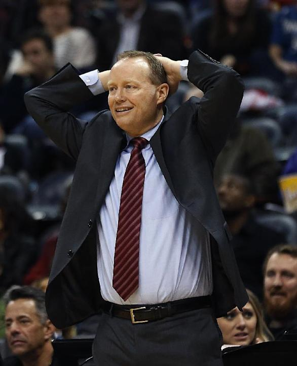 Atlanta Hawks coach Mike Budenholzer watches from in front of the bench in the second half of the Hawks' NBA basketball game against the Minnesota Timberwolves on Saturday, Feb. 1, 2014, in Atlant