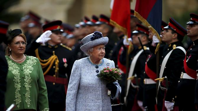 Britain's Queen Elizabeth and Malta's President Marie Louise Coleiro-Preca (L) inspect a guard of honour at San Anton Palace in Attard, after arriving for the Commonwealth Heads of Government Meeting (CHOGM) in Malta