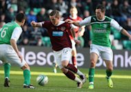 David Templeton, centre, has left Hearts for Rangers