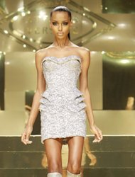 A model wears a creation by Fashion designer Donatella Versace as part of her Women&#39;s Spring Summer 2012/2013 fashion collection presented in Paris, Monday, Jan. 23, 2012. (AP Photo/ Jacques Brinon)
