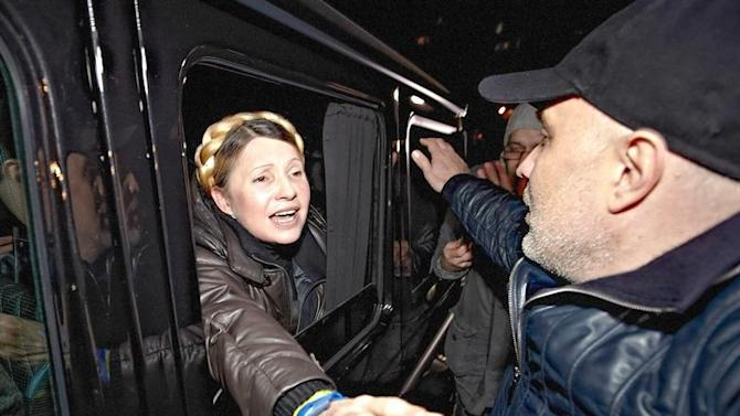 KIV20. Kharkiv (Ukraine), .- (FILE) A file picture made available 22 November 2014 shows Ukrainian opposition leader Yulia Tymoshenko greeting supporters from a car as she leaves the Central Clinical Hospital in Kharkiv, Ukraine, 22 February 2014, after she was released from a prison hospital in Kharkiv. Euromaidan, or Maidan movement, was a wave of protests that escalated into deadly civil unrest in Kiev, Ukraine. It started at the end of November 2013 and carried on for several months, leaving at least 100 people dead. Following the movement, Kiev is moving closer to future EU integration for the country, while parts of eastern Ukraine are in a state of turmoil. (Protestas, Ucrania) EFE/EPA/SERGEY KOZLOV *** Local Caption *** 51252375