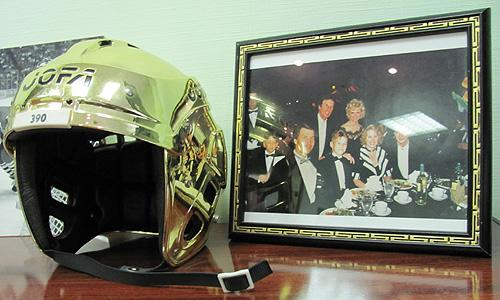 Everyone has a golden helmet by a framed photo of Detroit's Ilitch family in their office like Sergei Fedorov does, don't they?