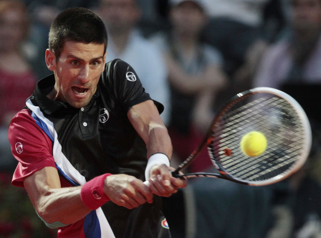 Serbia's Novak Djokovic returns the ball to Switzerland's Roger Federer during their semifinal match at the Italian Open tennis tournament, in Rome, Saturday, May 19, 2012. (AP Photo/Gregorio Borgia)