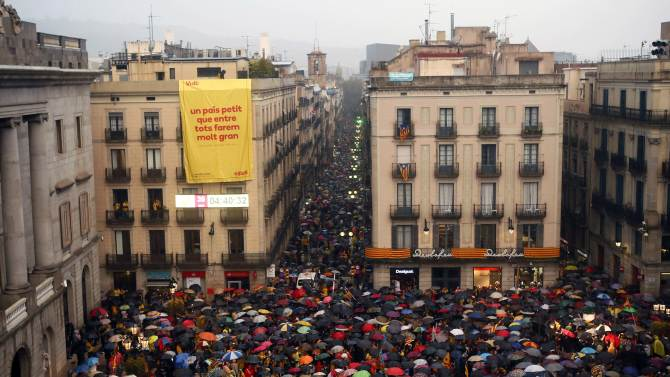 Catalan pro-independence supporters gather to protest against the Spanish Constitutional Court in front of the Generalitat de Catalunya in Barcelona